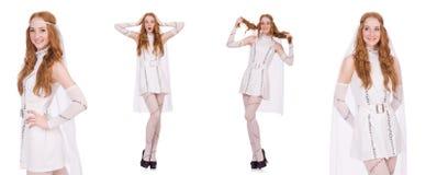 Den nätta damen i den ljusa charmiga klänningen som isoleras på vit Fotografering för Bildbyråer