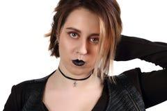 Den nätta unga flickan med svarta kanter poserar Fotografering för Bildbyråer