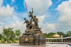 Den nationella monumentet kallade Tugu Negara i Kuala Lumpur, Malaysia arkivfoton