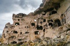 Den naturliga fästningen i vaggar i Uchisar, Cappadocia, Turkiet Oerhörda naturliga landskap Royaltyfri Bild
