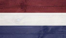 Den Netherland flaggan på wood bräden med spikar Arkivbild