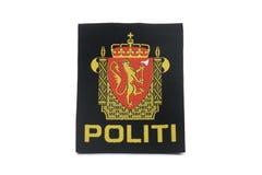 Den Norge polisen förser med märke Arkivfoton