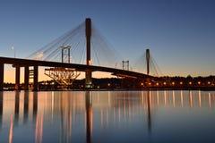 Den nya portMann bron på soluppgång Arkivfoton