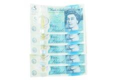 Den nya UK-polymern fem pund anmärkning som presenterar förhöjd counterfei fotografering för bildbyråer