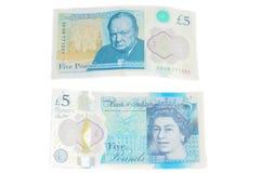 Den nya UK-polymern fem pund anmärkning som presenterar förhöjd counterfei royaltyfria bilder