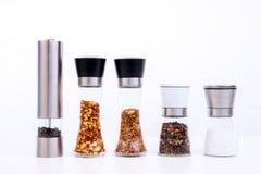 Den olika kryddan maler med salt, peppar och andra örter Royaltyfria Foton