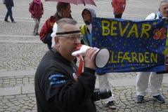 DEN OLIKA PROTESTEN SAMLAR Arkivbilder