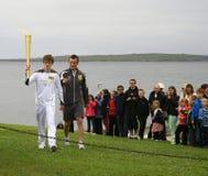 Den olympiska flamman landar på John O'Groats, Skottland Royaltyfria Bilder