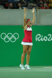 Den olympiska mästaren Monica Puig av Puerto Rico firar seger efter finalen för singlar för tenniskvinna` s av Rio de Janeiro 201 Royaltyfri Foto