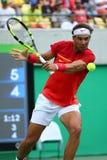 Den olympiska mästaren Rafael Nadal av Spanien i handling under singlar för man` s rundar fyra av Rio de Janeiro 2016 OS Royaltyfri Fotografi