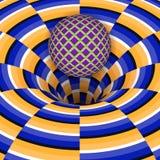 Den optiska illusionen av bollen faller in i ett hål Royaltyfri Foto