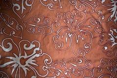 Den orange hawaianska hibiskusen mönstrade materiell bakgrund eller textur Royaltyfri Bild