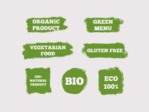 Den organiska produkten, den gröna menyn, vegetarisk mat, gluten frigör, naturlig 100%, Bio, Eco Uppsättning av gröna logoer stock illustrationer
