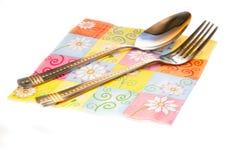 Den pappers- servetten och besticket Royaltyfri Fotografi