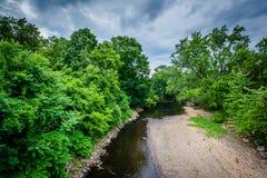 Den Piscataquog floden, i Manchester, New Hampshire Arkivfoto