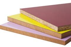 Den pläterade particleboardträflismaterialet används i möblemanget ind royaltyfri bild