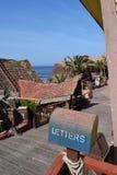Den Popeye byn, filmsetfamilj parkerar, ön Malta Arkivfoto