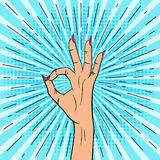 Den PopFemale handen visar det ok tecknet Illustration i stil för popkonst stock illustrationer