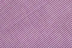 Den purpurfärgade tartanen mönstrar, rutigt tyg Arkivfoto