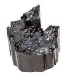 Den rå kristallen av den svarta tourmalinen Schorl isolerade Royaltyfri Foto