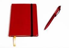 Anteckningsboken och skrivar Arkivfoton