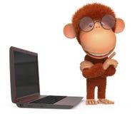 Den röda apan med bärbara datorn Arkivbild