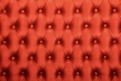 Den röda capitonen tufted tygstoppningtextur Fotografering för Bildbyråer
