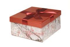 Den röda gåvan boxas Arkivfoto