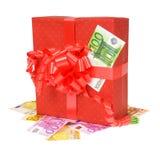 Den röda gåvan boxas med pengar Royaltyfria Bilder