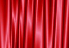 Den röda gardinen reflekterar med den ljusa fläcken på bakgrund Royaltyfria Foton