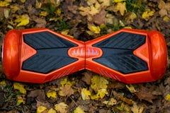 Den röda hoverboarden en bästa sikt Arkivfoto
