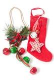 Den röda julstrumpan och klirr sätta en klocka på royaltyfria bilder