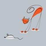 Den röda katten fångar en mus Royaltyfri Bild