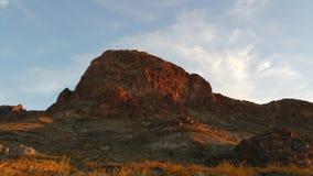 Den röda kullen vaggar Arkivbild