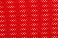 Den röda polkaen pricker tyg Royaltyfri Fotografi