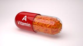Den röda preventivpilleren eller kapseln fyllde med vitamin A Arkivbild