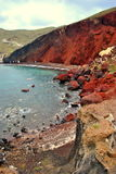 Den röda stranden Arkivbild