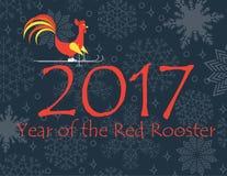 Den röda tuppridningen skidar på av numret 2017 som snöar bakgrund Royaltyfri Foto
