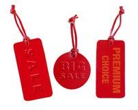 Den röda uppsättningen för läderförsäljningsetiketten, utföra i relief ord Royaltyfria Bilder
