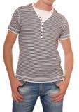 Den randiga t-skjortan och jeans är på man arkivbild