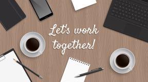 Den realistiska arbetsplatstabellen med citationstecken 'lät oss arbetar tillsammans', Fotografering för Bildbyråer