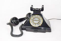 Den Retro telefonen, mottagare valde upp och lagt bredvid telefonen arkivfoto