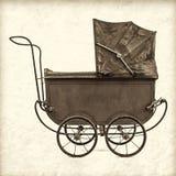 Den Retro utformade bilden av en tappning behandla som ett barn sittvagnen Arkivfoto