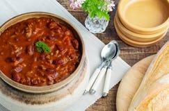 Den rika smakliga chili lurar rottingen Arkivbild