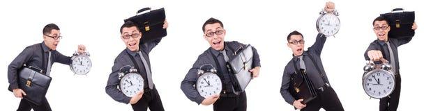 Den roliga affärsmannen med klockan som isoleras på vit Arkivfoton