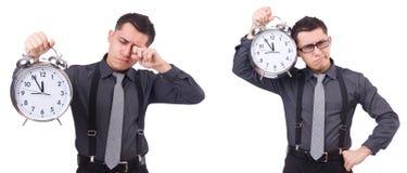 Den roliga affärsmannen med klockan som isoleras på vit Royaltyfri Fotografi