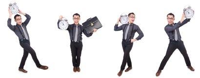 Den roliga affärsmannen med klockan som isoleras på vit Royaltyfria Bilder