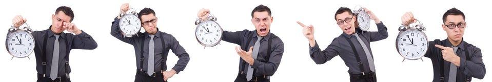Den roliga affärsmannen med klockan som isoleras på vit Royaltyfri Bild