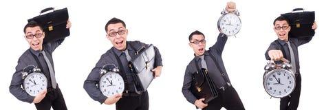 Den roliga affärsmannen med klockan som isoleras på vit Arkivbilder
