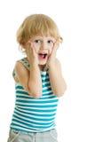 Den roliga barnpojken med händer vänder mot nästan isolerat på vit bakgrund royaltyfri fotografi